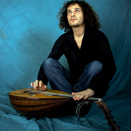 Smadj posing with the oud instrument